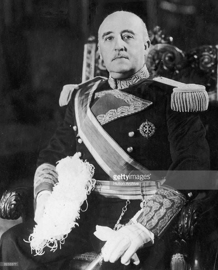 1935. A portrait of Spanish dictator Francisco Franco (1892 - 1975) sitting on a throne in full military regalia.