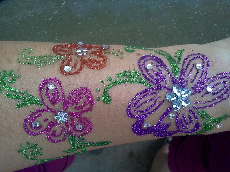 Glitter Tattoo by Twinkle Tattoos. Freehand style by Amber