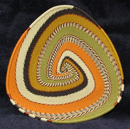 """New Shape - Triangle Plate  Wonderful Modern Craft  Beautiful, Even, Solid Weave  Change in Colors, Direction and Weave Creates Pattern  Plate has approximately 7"""" long sides and is flat with a 3/4"""" tall edge."""