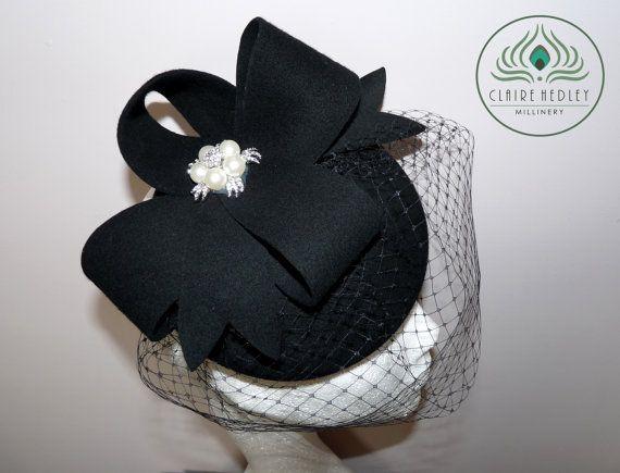 Black felt pillbox cocktail hat with black birdcage veil