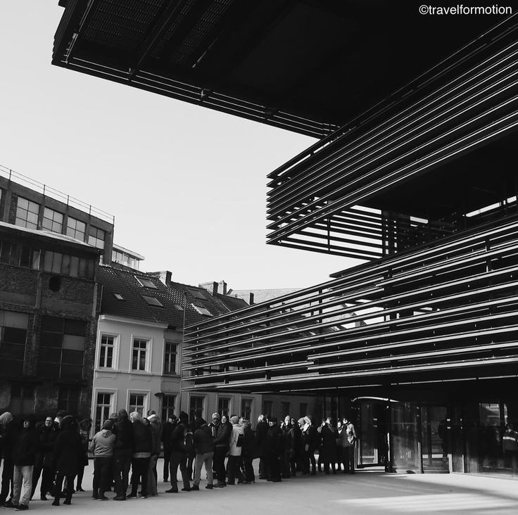 #knowledge is #displaceable #ghent #gent #blackandwhite #blackandwhitephotography #architecture #architecturephotography #people moving #books to the new #library #ghentcity #flanders #belgium #belgium_unite #vsco #vscocam #wanderlust #visitgent