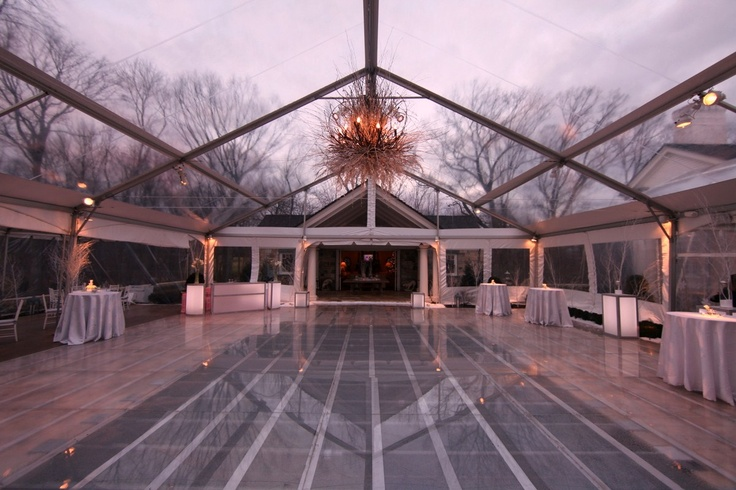 Dance Floor Over the Pool with Clear Tent // Skyline Tent Company