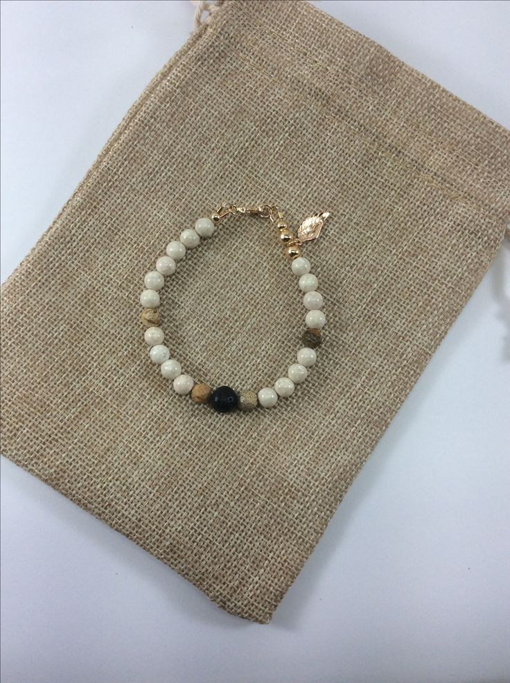 Essential oil diffuser jewellery, add oil to lava stone. All orders come with 1ml vial of Wild Orange and woven bag.