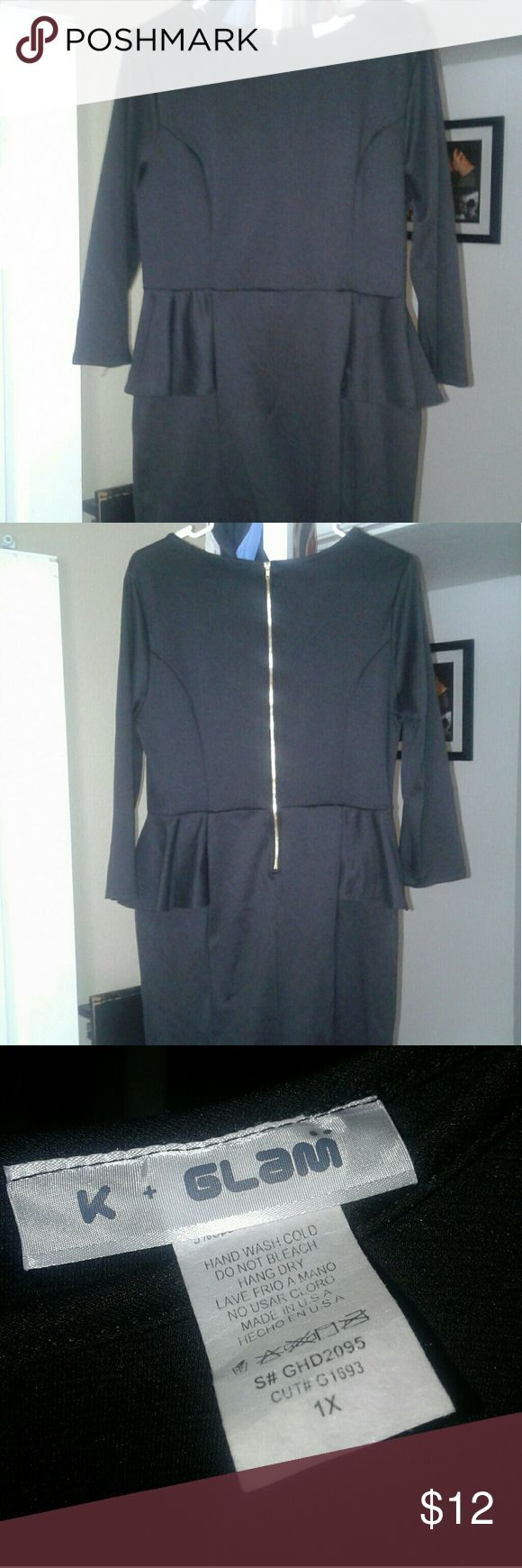 NWOT Plus Size Black Peplum Dress 1X NWOT purchased secondhand,  no flaws. Black peplum dress, 3/4 sleeve, thicker material but soft with some stretch. Zippered detail back.  Size 1X K+Glam Dresses