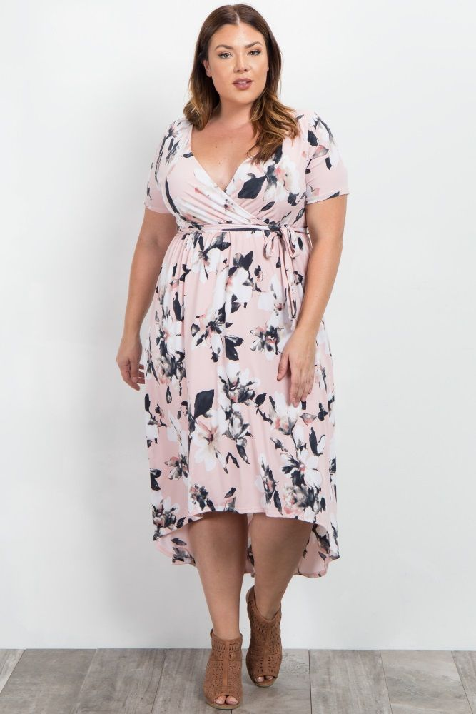 Floral print plus size wrap dress. Hi-low hemline. Sash tie. Short sleeves. Double lined top prevent sheerness.