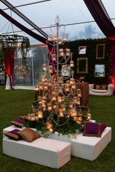 Chandelier put on the ground, out of the box Indian wedding décor idea.