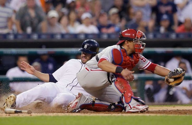 Martinez Slides:    Detroit Tigers' J.D. Martinez beats the throw to Philadelphia Phillies catcher Carlos Ruiz to score on, May 24, in Detroit. The Tigers won 3-1.