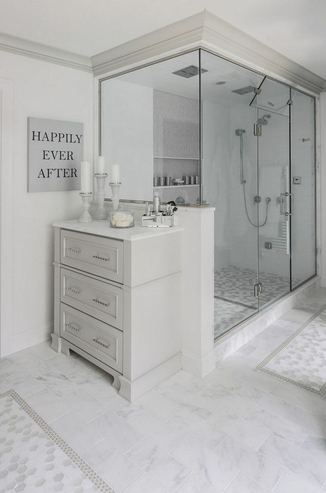 Bathroom with extra cabinet by shower - perfect to store extra towels, soap, shampoo, etc