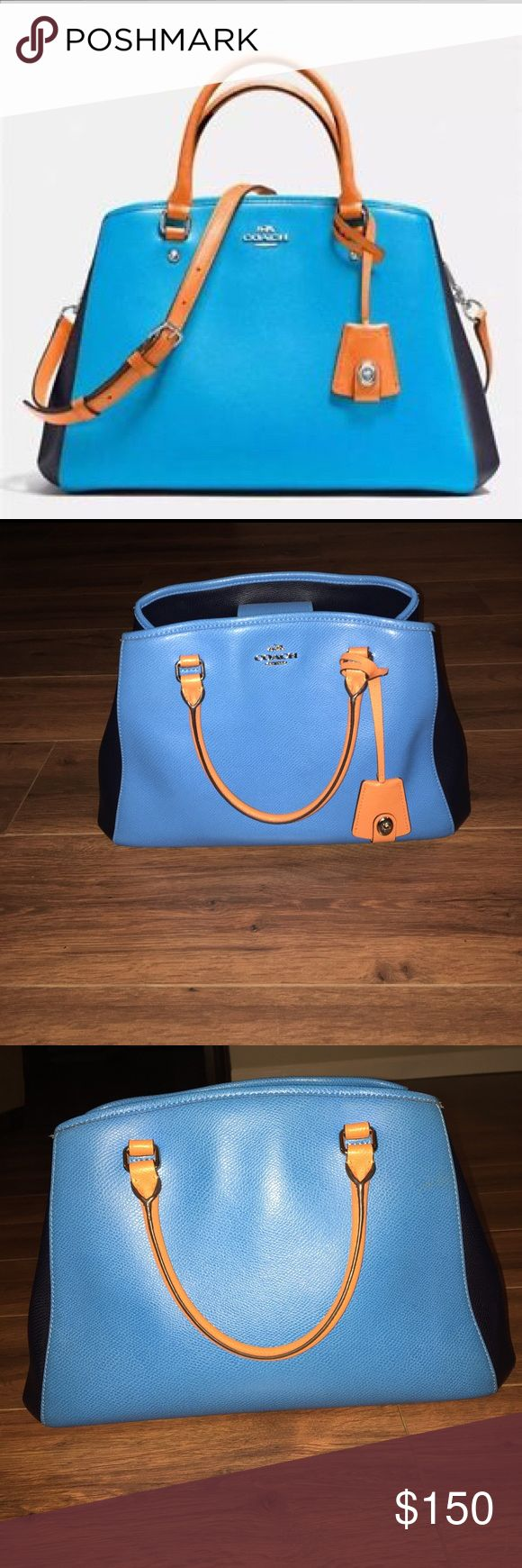 Coach Margot Purse Blue colorblock with navy and orange trim Margot purse. I still have the cross body strap, I never used it, it is still like I received it, wrapped. Every time I carry this bag, someone compliments it. I also have a wallet to match, listing coming soon. This bag is in excellent shape! Coach Bags Crossbody Bags