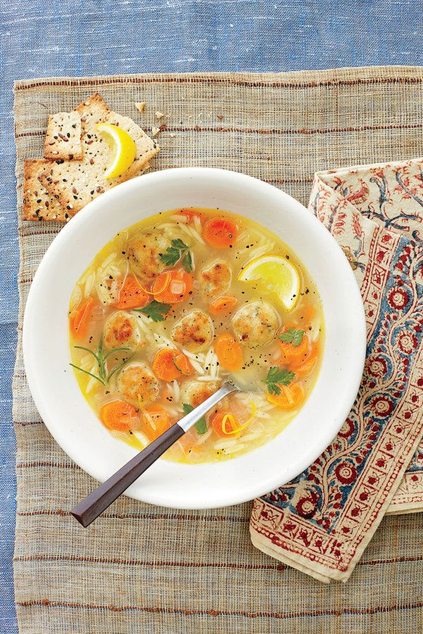 This hearty twist on chicken noodle soup features small grains of orzo pasta and savory chicken meatballs.