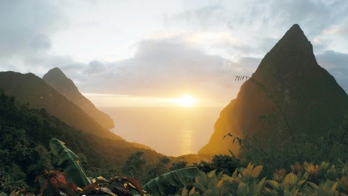 Around 1,100 feet above the Caribbean Sea, Ladera overlooks the Piton Mountains.: Caribbean Sea, St Lucia, Resorts, Sunsets, Stlucia, Lucia Jetsettercur, Honeymoons, Place, St. Lucia