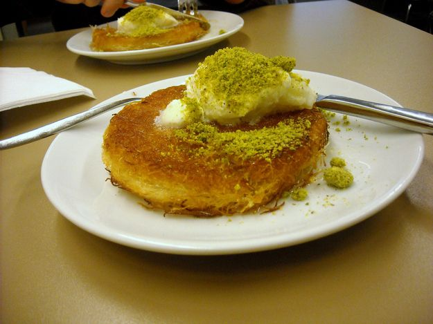 Künefe | What is it: Shredded phyllo dough encasing a sweet cheese, topped with pistachios and honey.