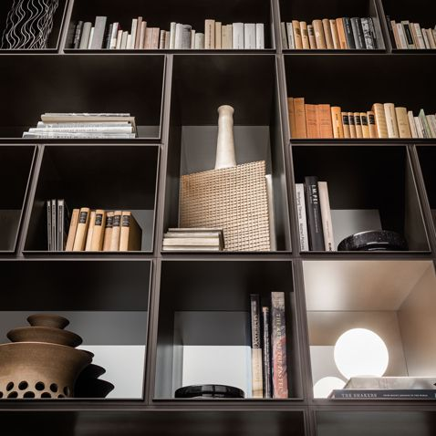 Opus bookcase in brown aluminum and back panels in cacao reflex lacquered glass