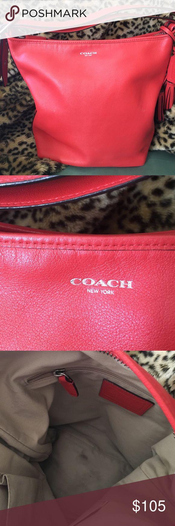 Coach Legacy shoulder bag Coach Legacy shoulder bag in vermillion. Adjustable shoulder strap. Small lotion stain in bottom of inside. Includes dust cover. Coach Bags Shoulder Bags