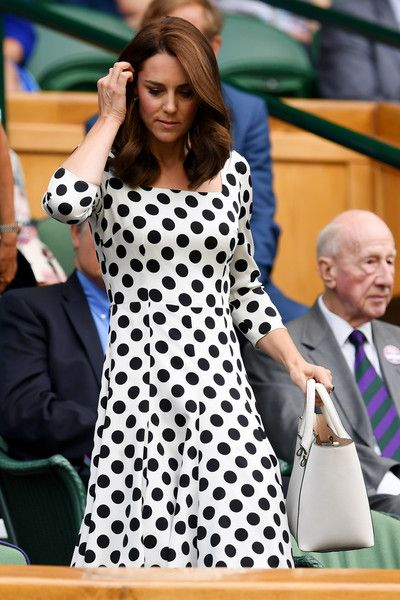 Kate Middleton Photos Photos - Catherine, Duchess of Cambridge looks on from centre court on day one of the Wimbledon Lawn Tennis Championships at the All England Lawn Tennis and Croquet Club on July 3, 2017 in London, England. - Day One: The Championships - Wimbledon 2017