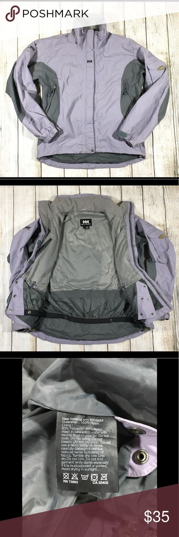"Women's Waterproof Winter Snow Jacket Coat L Helly Hansen Tech  Womans  Winter Jacket Coat   Waterproof Snow Ski  purple Gray  Size: L Great pre-owned condition, but -- No hood! Measurements taken laying flat: Chest: 24"" Sleeve length from collar: 31"" Sleeve length from armpit: 24"" Overall length: 25"" Bottom width: 22.5"" Helly Hansen Jackets & Coats"