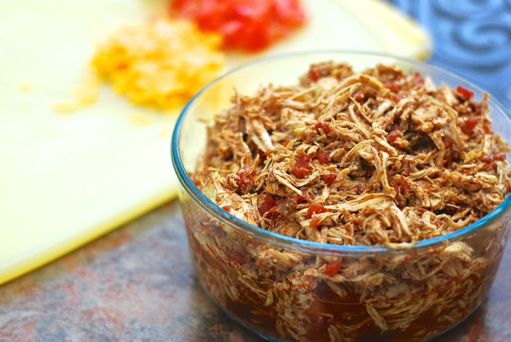 Spicy Shredded Chicken For Tacos, Nachos, Enchiladas, etc.  Made these and they were a complete hit with the hubby!  Ridiculously easy - throw in the crockpot and forget about it! KC