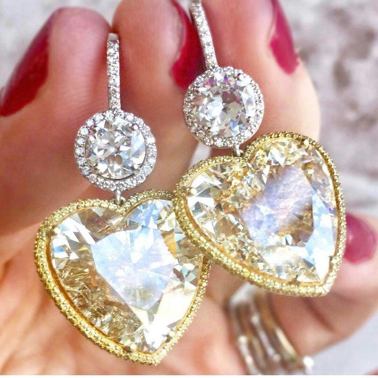 Fancy yellow heart shaped diamonds with white diamonds earrings
