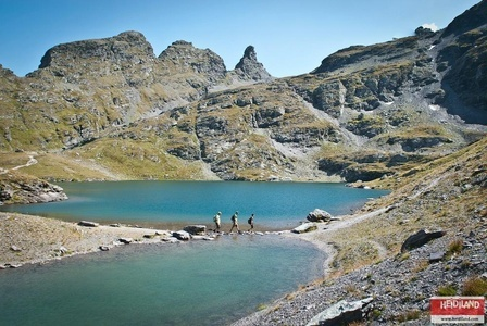 Hiking along the Schwarzsee Lake on the famous 5-Lakes-Hike on Pizol.
