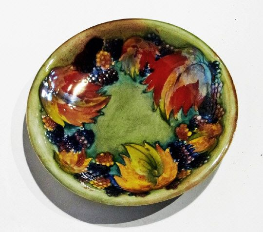 "Moorcroft flambe ""Leaf and Berry"" shallow dish with impressed mark ""Potter to the Queen, made in England"" and signature ""W Moorcroft"" in blue, 19cm diameter Estimate £500.00 to £700.00 (Lot no: 63 in sale on 05/08/2014) The Cotswold Auction Company"