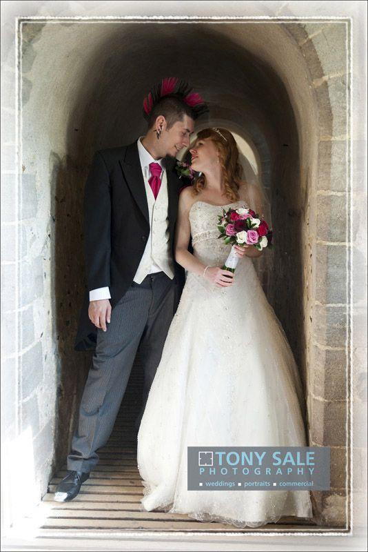 Very cool bride and groom, wedding at Hedingham Castle in Essex