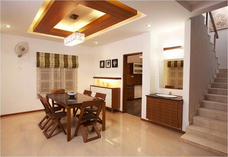 Dining room with wooden suspended ceiling savio and rupa for Interior designs in bangalore