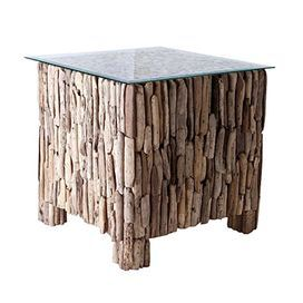 "Collected from the shores of Bali, the weathered driftwood remnants that adorn this side table rustically complement a clear glass top.   Product: Coffee tableConstruction Material: Driftwood and glassColor: NaturalFeatures:  Handcrafted from driftwood collected on the shores of BaliGlass top included Dimensions: 20"" H x 20"" W x 20"" D"