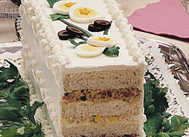 I've made this Ribbon Sandwich Loaf for baby and wedding showers, birthdays and tea parties and is always a hit, I use a cranberry cashew chicken salad layer and a strawberry cream cheese layer
