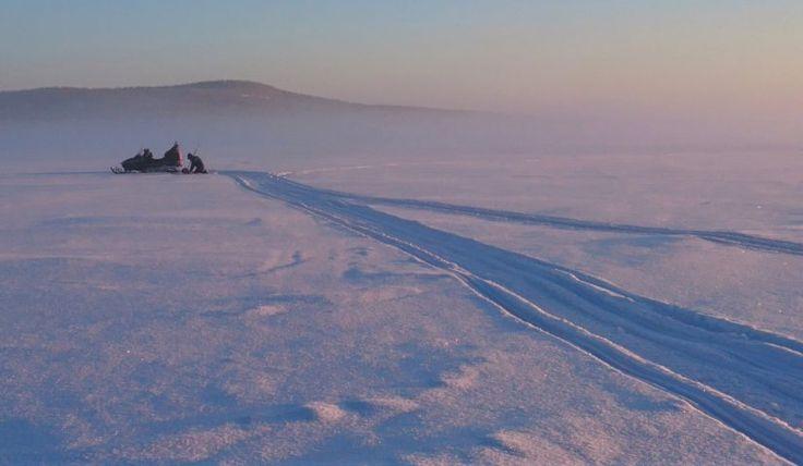 Ice fishing in Lake Miekojärvi in Pello in Lapland