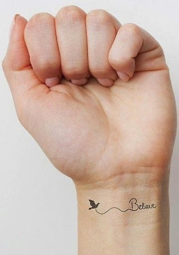 small quote believe tattoo on wrist
