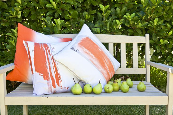 Our stunning Tempest cushions that come in orange, blue and grey