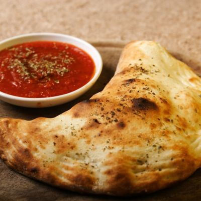 Crispy Italian Style Calzone with Gooey Cheese Filling
