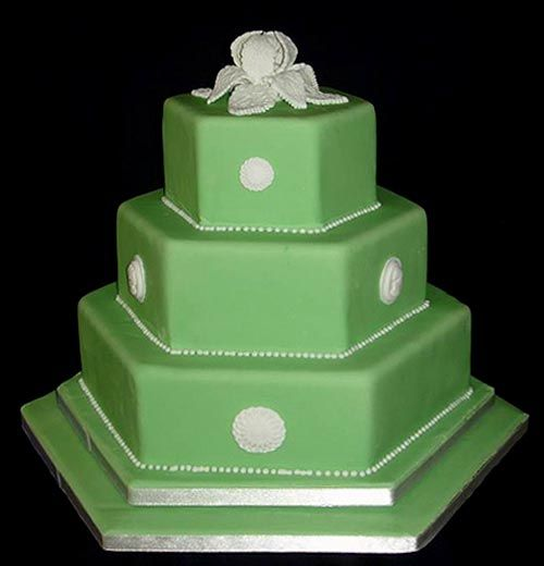 love, love, love this three tier hexagon green fondant wedding cake, decorated with white emblems and a handmade fondant flower as the wedding cake topper. from traceyt197 (see link to her flickr).