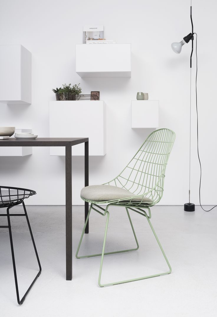 Set of armchairs and rocking chairs just out from beneath the shelter - Pastoe Sm05 Chair In Green Design Cees Braakman
