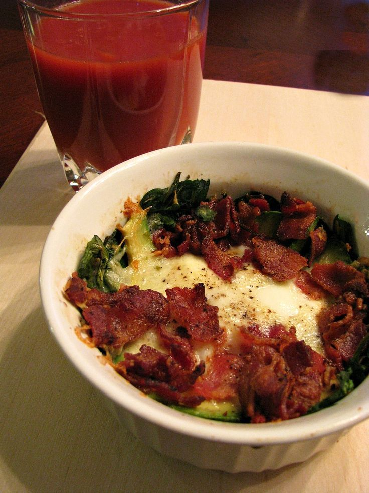 Baked Eggs with Spinach Bacon and Avocado- Baked eggs with spinach, bacon, and sliced avocado perfect for Sunday brunch!