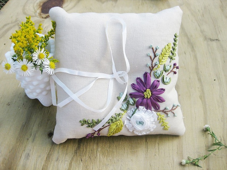 The ribbon embroidery is so pretty!! -- Ring pillow with ribbon embroidered flowers in white, purple, and blue.. $95.00, via Etsy.