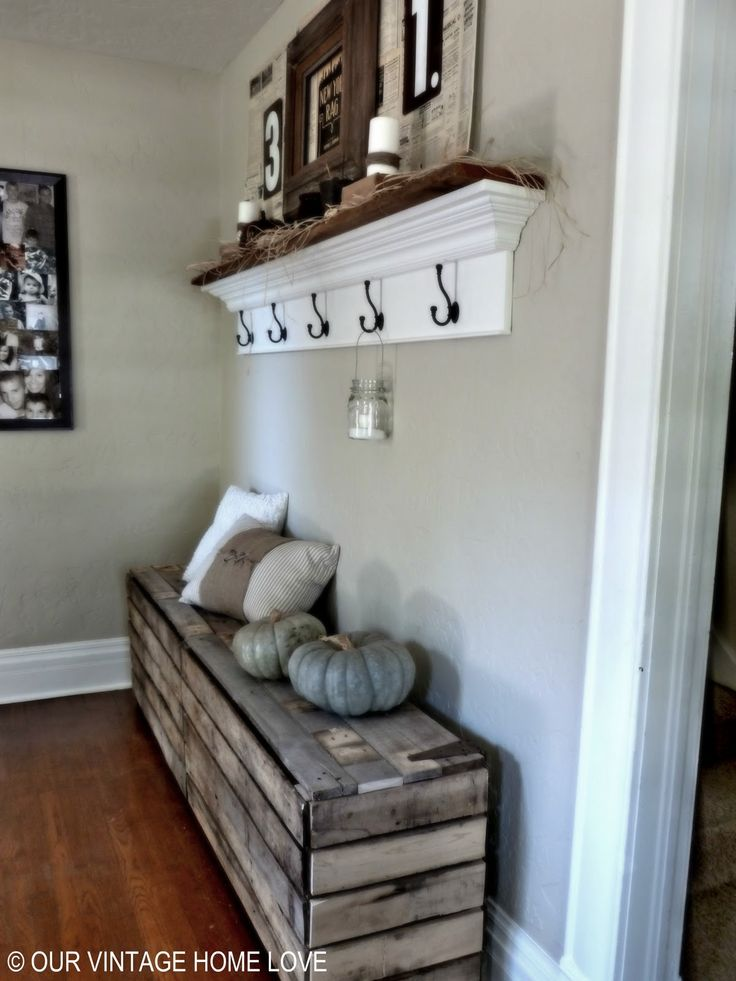 Love this for shoe storage. Pallet storage bench with rustic hinges