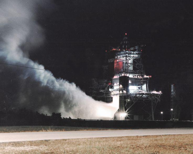 A Space Shuttle Main Engine, (SSME) test firing lights up ...