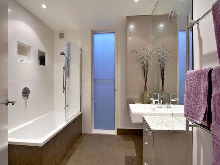 Photo Of A Art Deco Bathroom Design With Claw Foot Bath Using Frameless Glass From The