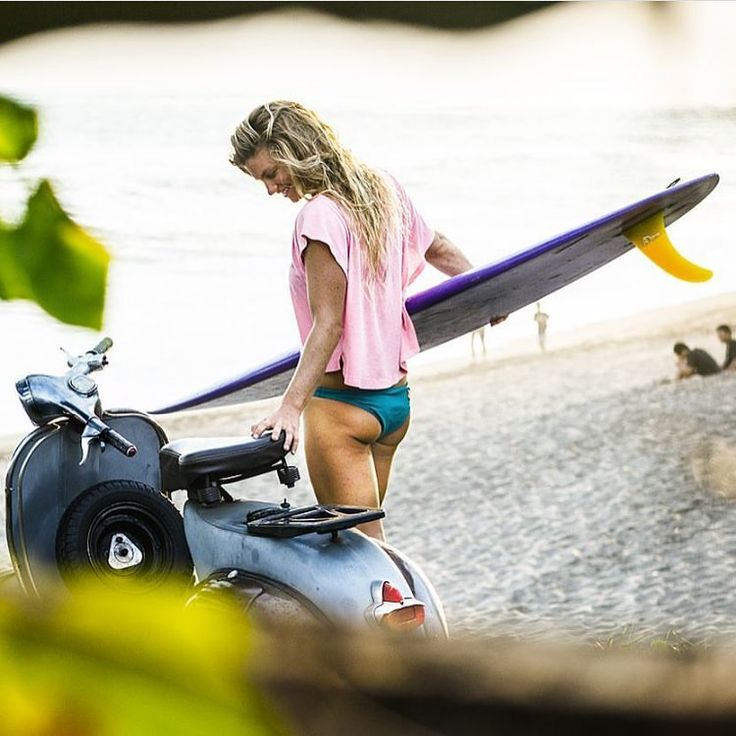 Not certain how she carried the surf board on a Vespa but anything is possible.