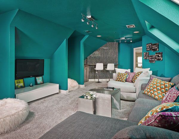 Awesome Striking Blue Family Room Hangout Featuring TV Wall Mounted, Modern Cozy Seating, Cool Mini Bar, Minimalist Coffee Table, and Soft F...