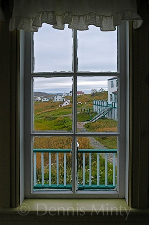 Window with a view of Battle Harbour, Labrador, Canada