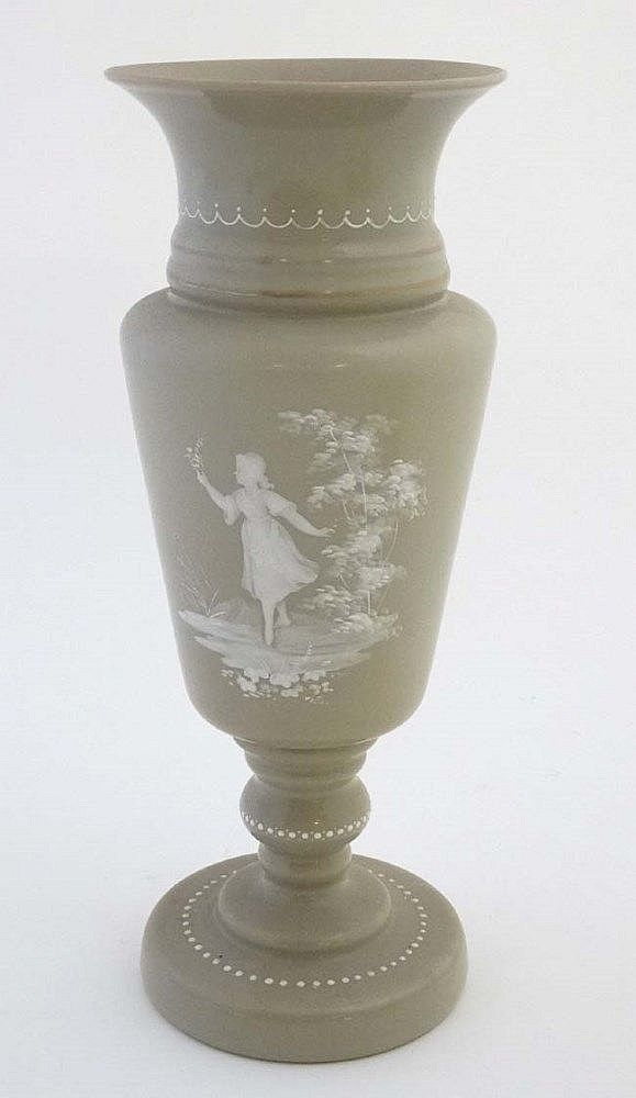A Victorian sage coloured opaque glass vase with white enamelled Mary Gregory style decoration 13 1/2'' high