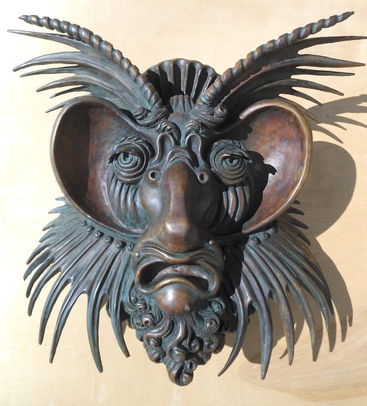 New set of bronze cast patinated mask heads, based on famous Cornelis Floris designs circa1555.