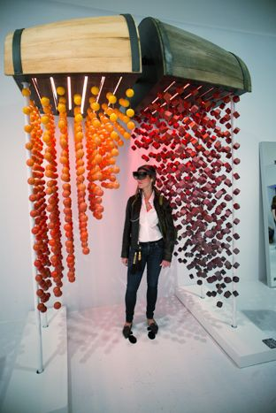 At the Macallan Gallery 12 exhibit, held in October in New York, visitors used HoloLens devices to visually experience the whiskey's flavor notes such as honey, citrus, cinnamon, and ginger as they rained down from suspended casks.