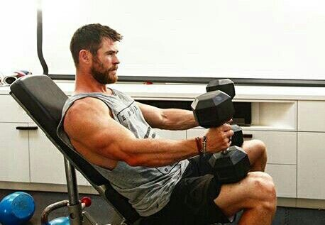 Chris working out . Love those biceps
