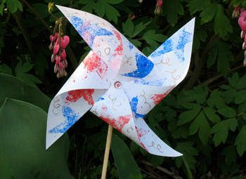I just made this using items I had on hand, but if we do it at camp I think we'd use straws and those two prong fasteners.  The pinwheels are brilliant because they can be made and used that day. For instance if we made them on the fourth they could carry them to the celebration and watch them twirl in the breeze. I really like this idea.