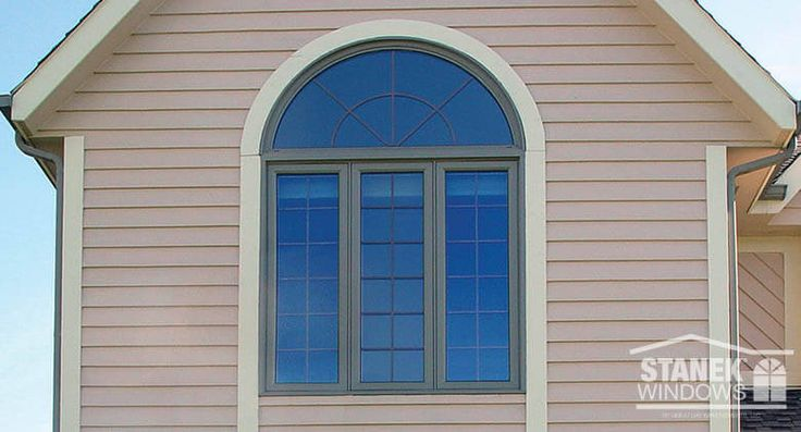 Three-lite casement with half-circle window above. Colonial grids in all. Learn more about Stanek Casement Windows.