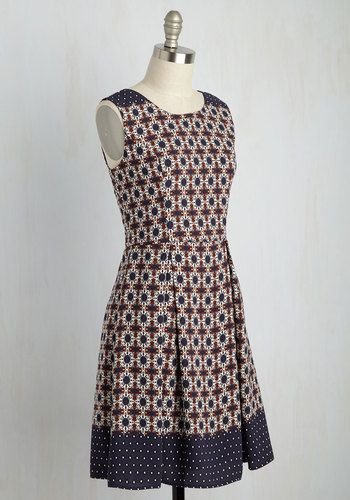 Ensure your feats of design shine both in and out of the office by sporting this patterned dress. Emblazoned with a navy, white, and red architectural print, a colorblocked hem and shoulders, and a pleated skirt, this dress is an exultant expression of your career!