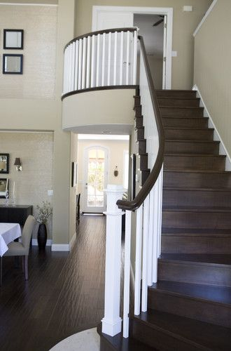 Handscraped hardwood floor with dark chocolate painted railing, risers, and treads. *I'd do white risers to lighten it up...